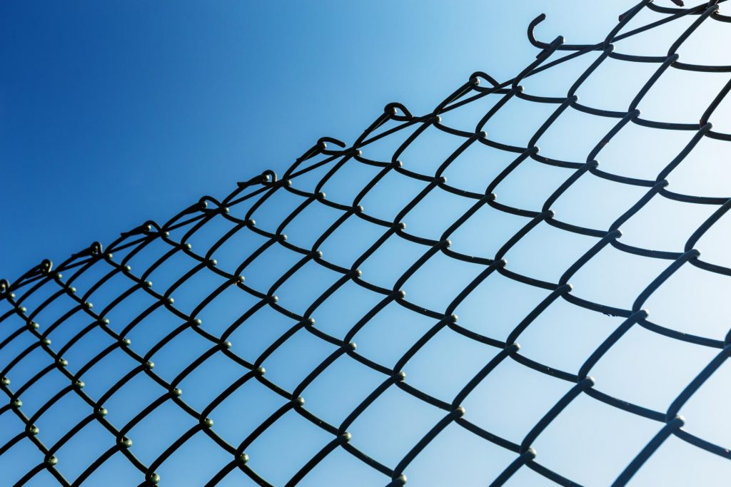 reliable chain link and wooden fence